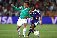 Giovani dos Santos of Mexico (L) and Florent Malouda of France (R)