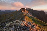 Rocky summit of Tønsåsheia at sunrise in autumn, Lofoten Islands, Norway