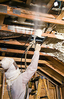 Environmentaly friendly and money saving, spraying insulation into ceiling to conserve electricity.