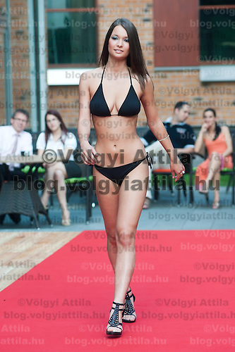 Evelin Grof a participant of the Beauty Queen contest attends a bikini tour in Hotel Abacus, Herceghalom, Hungary on July 07, 2011. ATTILA VOLGYI