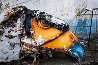 A damaged carnival sculpture of a bird abandoned on the work yard behind the Samba school workshops in Rio de Janeiro, Brazil, 13 February 2012. Most of the large carnival floats, colorful designs and fancy costumes are dismantled, cut into pieces or simply thrown into garbage right after the last day of the Carnival. The low-tech materials as fiberglass, plastic or polystyrene, which most of the of the carnival floats and statues are made of, are stocked in the warehouses to be recycled and used in the future parades. However, there is no use for some of the statues so they slowly fall apart into pieces forming a ?Carnival cemetery? in the industrial yards around the port of Rio de Janeiro.