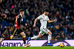 Marco Asensio Willemsen of Real Madrid (R) is followed by Alvaro Medran of Rayo Vallecano during the La Liga 2018-19 match between Real Madrid and Rayo Vallencano at Estadio Santiago Bernabeu on December 15 2018 in Madrid, Spain. Photo by Diego Souto / Power Sport Images