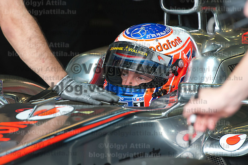 McLaren Formula One driver Jenson Button of Britain stops in the pit during the free practice session of the Hungarian F1 Grand Prix in Mogyorod (about 20km north-east from Budapest), Hungary. Thursday, 28. July 2011. ATTILA VOLGYI