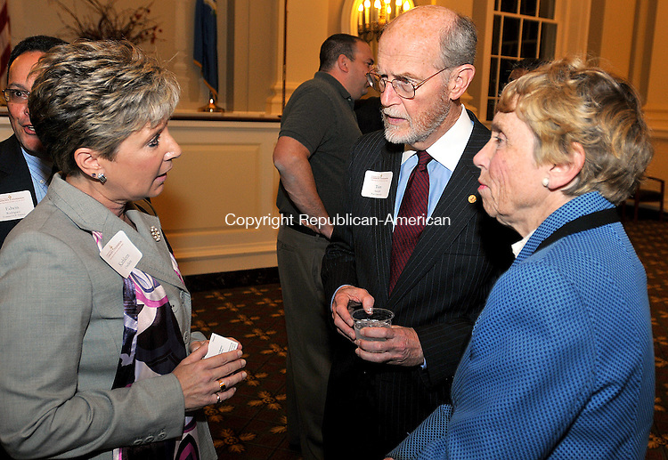 WATERBURY, CT, 10 NOVEMBER 2011-111011JS05-New Waterbury School Superintendent Kathleen Ouellette, left, talks with Tom Samph, President and CEO of Post University, center, and Ingrid Manning, CEO of the Connecticut Community Foundation, during a reception Thursday at Waterbury City Hall. The event was sponsored by the Connecticut Community Foundation.  Jim Shannon Republican-American