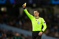Referee Slavko Vincic issues a yellow card during the UEFA Champions League Group C match between Manchester City and Shakhtar Donetsk at the Etihad Stadium on November 26th 2019 in Manchester, England. (Photo by Daniel Chesterton/phcimages.com)
