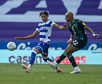 Swansea City's Andre Ayew (right) crosses the ball despite the attentions of Reading's Liam Moore (left) <br /> <br /> Photographer David Horton/CameraSport<br /> <br /> The EFL Sky Bet Championship - Reading v Swansea City - Wednesday July 22nd 2020 - Madejski Stadium - Reading <br /> <br /> World Copyright © 2020 CameraSport. All rights reserved. 43 Linden Ave. Countesthorpe. Leicester. England. LE8 5PG - Tel: +44 (0) 116 277 4147 - admin@camerasport.com - www.camerasport.com