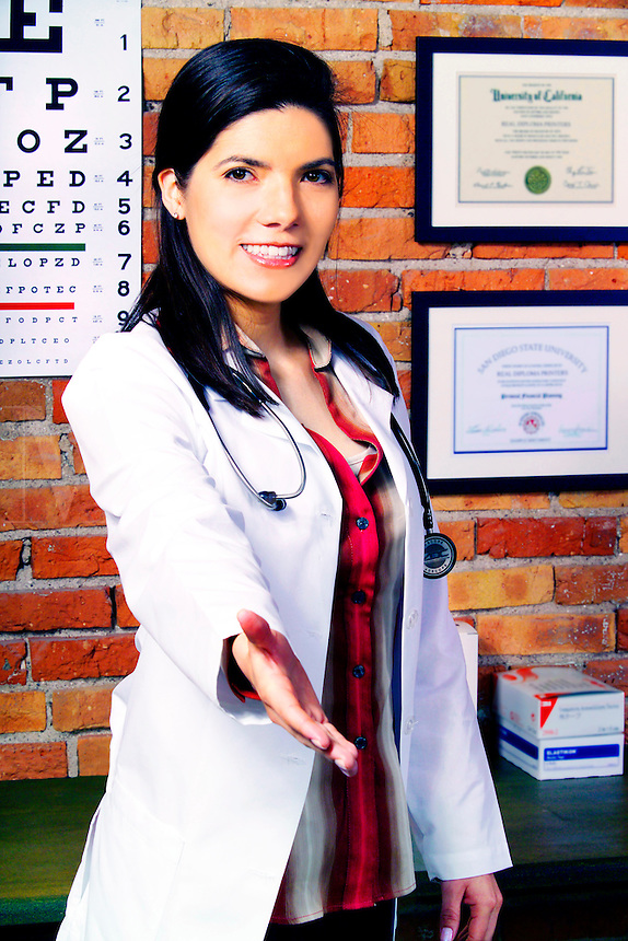 Female doctor extending her arm to shake your hand.