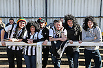Grimsby Town fans wearing wigs before the Vanamara Conference League match between Woking and Grimsby Town at the Kingfield Stadium, Woking, Surrey<br /> Picture by David Horn/eXtreme aperture photography +44 7545 970036<br /> 07/03/2015