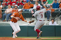 Texas Longhorns first baseman Alex Silver #11 tags out Oklahoma Sooners baserunner Anthony Hermelyn #9 in the NCAA baseball game on April 5, 2013 at UFCU DischFalk Field in Austin Texas. Oklahoma defeated Texas 2-1. (Andrew Woolley/Four Seam Images).