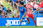 Getafe CF's Gaku Shibasaki (l) and Atletico de Madrid's Lucas Hernandez during friendly match. August 11,2017. (ALTERPHOTOS/Acero)