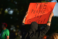 July 14, 2013  (Washington, DC) A woman holds a sign as hundreds of people gathered at Meridian Hill (Malcolm X) Park to protest the acquittal of George Zimmerman after his trial for killing Trayvon Martin. (Photo by Don Baxter/Media Images International)