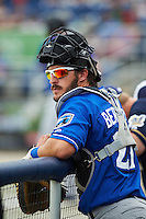 Biloxi Shuckers catcher Parker Berberet (21) in the dugout during the first game of a double header against the Pensacola Blue Wahoos on April 26, 2015 at Pensacola Bayfront Stadium in Pensacola, Florida.  Biloxi defeated Pensacola 2-1.  (Mike Janes/Four Seam Images)