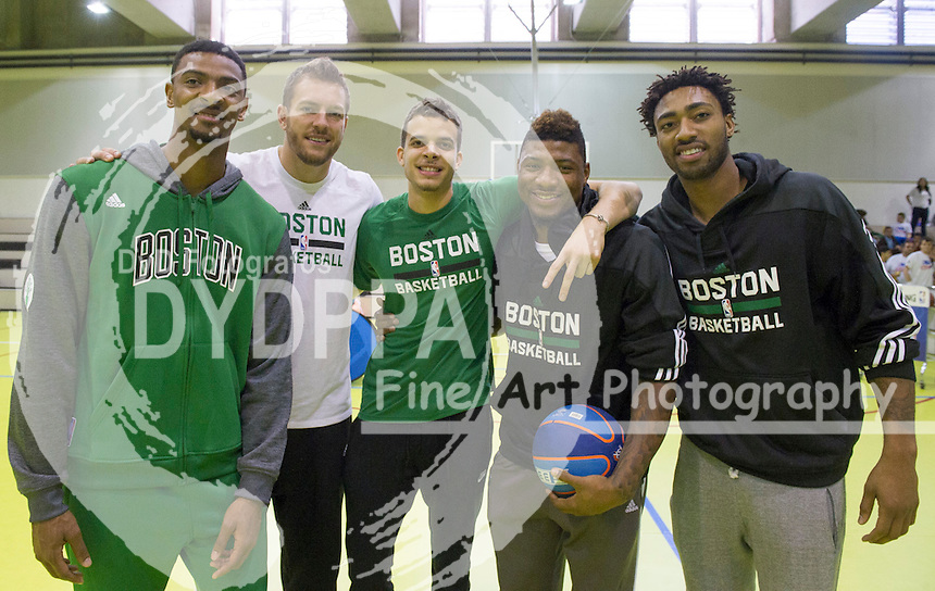 Boston Celtics basketball players Jordan Mickey, David Lee, R. J. Hunter, Marcus Smart and James Young