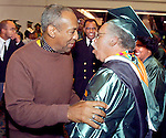 Entertainer and comedian Bill Cosby (L) greets his brother Russell Cosby (R), 60  years old,  just prior to his brother's graduation with a political science degree from Florida A & M University in Tallahassee, FL December 12, 2003.  The comedian not only came to see his brother graduate but delivered the commencement address to the 750 graduates of the only public historically black university in Florida, Florida A&M University.  (Mark Wallheiser/TallahasseeStock.com)