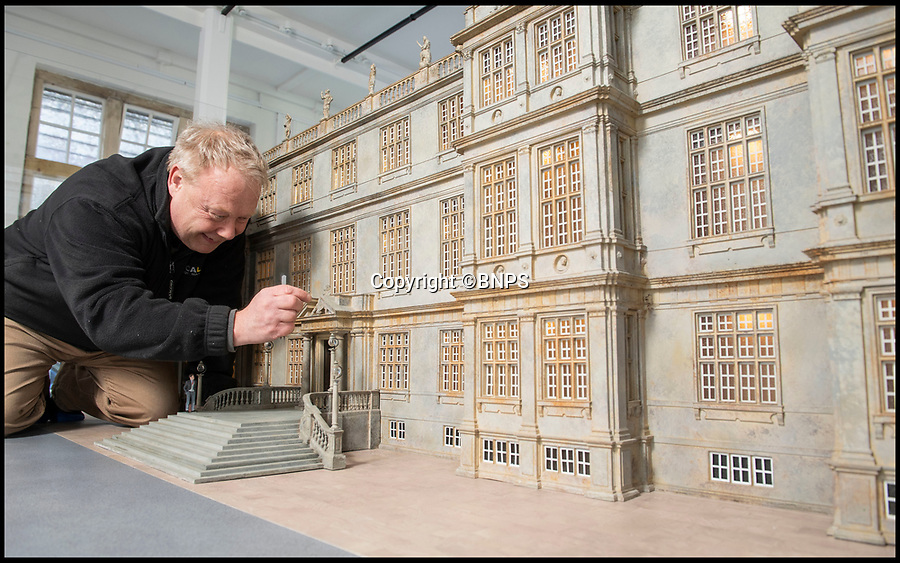 BNPS.co.uk (01202 558833)<br /> Pic: PhilYeomans/BNPS<br /> <br /> Modelmaker Kim Ward(60) tidys up the impressive Elizabethan facade.<br /> <br /> This stunning model of one of Britain's finest stately homes has been painstakingly restored after languishing in a store room for the last seven years.<br /> <br /> The 1/25 scale model of Longleat House in Wiltshire was commissioned by the 6th Marquess of Bath in 1988 and went on display in the 16th Century mansion's butchery.<br /> <br /> But it was broken up into 50 pieces and put into storage when the home underwent renovations several years ago.<br /> <br /> Kim Ward, 60, and his six man team have spent the past two months restoring the model to its former glory.