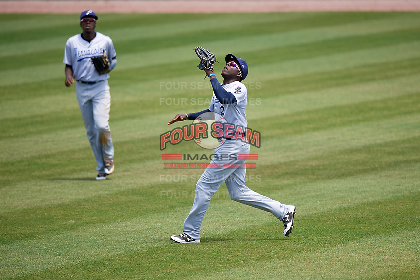 Pensacola Blue Wahoos right fielder Aristides Aquino (2) tracks a fly ball in front of center fielder Gabriel Guerrero (23) during a game against the Mobile BayBears on April 26, 2017 at Hank Aaron Stadium in Mobile, Alabama.  Pensacola defeated Mobile 5-3.  (Mike Janes/Four Seam Images)