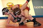 SIOUX FALLS, SD - DECEMBER 28:  Brandon Carroll from Roosevelt has control of Jacob Puppe from Brookings in their 106 pound championship match Saturday afternoon December 28, 2013 at Lincoln High School in Sioux Falls, South Dakota. (Photo by  Dave Eggen/Inertia)