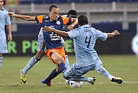Karim Alt Fana (18) forward Montpellier tackled by Kevin Ellis (4) defender Sporting KC..Sporting Kansas City were defeated 3-0 by Montpellier HSC in an international friendly at LIVESTRONG Sporting Park, Kansas City, KS..