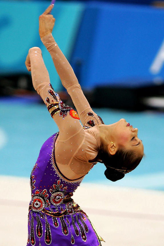 Irina Tchachina of Russia mills with clubs during qualification round at 2004 Athens Olympic Games on August 27, 2006 at Athens, Greece. Irina won silver in the All-Around final. (Photo by Tom Theobald)