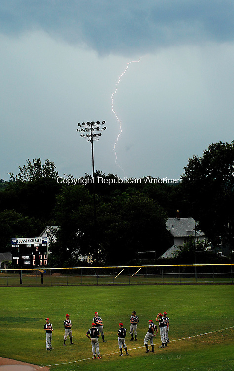 "Torrington, CT- 21, July 2010-072110CM07  Lighting strikes as Moosup players toss a baseball around during a game of ""two ball"" at Fuessenich Park in Torrington.  The American Legion game against Torrington was cancelled due to inclement weather.   --Christopher Massa Republican-American"