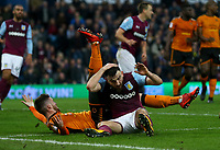 Robert Snodgrass of Aston Villa knocked on the head by challenge from Matt Doherty of Wolverhampton Wanderers <br /> <br /> Photographer Leila Coker/CameraSport<br /> <br /> The EFL Sky Bet Championship - Aston Villa v Wolverhampton Wanderers - Saturday 10th March 2018 - Villa Park - Birmingham<br /> <br /> World Copyright &copy; 2018 CameraSport. All rights reserved. 43 Linden Ave. Countesthorpe. Leicester. England. LE8 5PG - Tel: +44 (0) 116 277 4147 - admin@camerasport.com - www.camerasport.com
