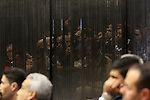 Suspects in the 'Port Said Massacre' case, sit in a courtroom cage during their trial in Cairo on December 23, 2014. The defendants were originally given sentences ranging from 15 years to life in prison. They were convicted of the murder of over 70 Ahly fans, nine security personnel and three officials from Al-Masry Club at a football match in Port Said in February 2012. Photo by Amr Sayed