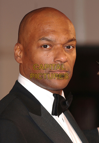 COLIN SALMON.Arriving at the 2007 Orange British Academy Film Awards (BAFTAs) at the Royal Opera House, London, England, 11th February 2007..headshot portrait bow tie soul patch facial hair .CAP/ BEL.©Tom Belcher/Capital Pictures.
