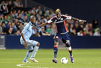 Saer Sene (39)  New England forwrad holds off Julio Cesar Sporting KC... Sporting Kansas City defeated New England Revolution 3-0 at LIVESTRONG Sporting Park, Kansas City, Kansas.