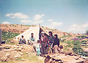 Iraq 1991 .In the village of Der  Awar in Germian, a man with his wife and children in front the tent on the ruins of his house. He lost many children during Anfal  .Irak 1991 .Dans le village de Der Awar dans la region de Germian, Mohamed Saleh Mala Hassan avec sa femme Amina et ses enfants vivent dans une tenrte sur les ruines de sa maison. Il a perdu des  enfants dans l'Anfal