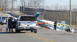Sentinel/Dan Irving.Holland, Mich police officers secure the scene of a plane crash near Tulip City Airport.  The plane came down short of the runway on Monday night..(3/7/06)