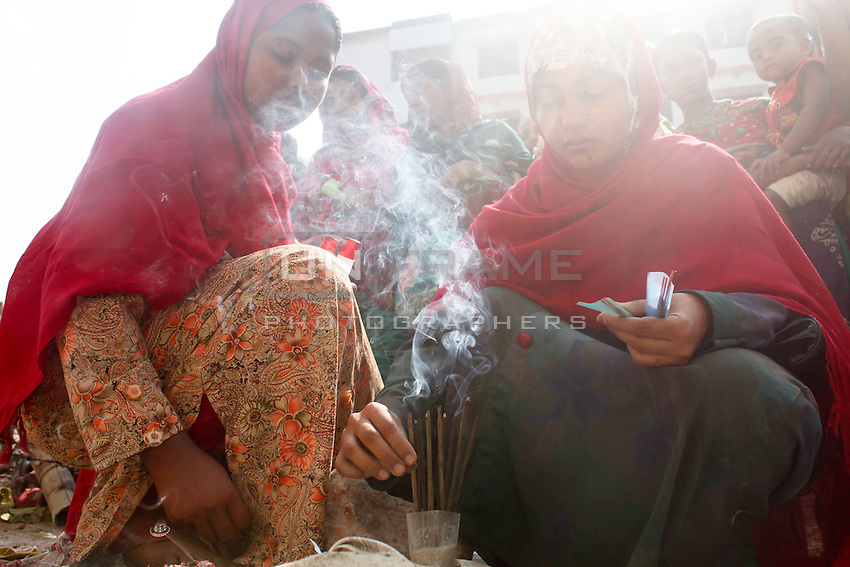 Relatives of victims burn Incense sticks as a part of the ritual.