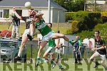 David Roche Milltown-Castlemaine and Jonathan Lyne Legion contest the kick out during their SFC clash in Killorglin on Sunday
