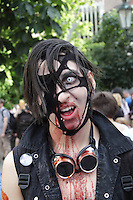 Male participant in the prague zombie walk may 2014. Headshot, wearing black vest and googles around his neck, open mouth.
