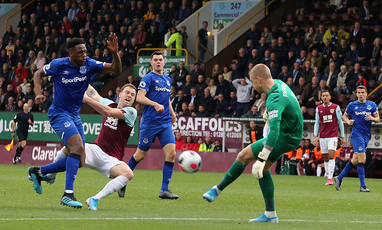 Burnley's Ashley Barnes goes down under the challenge from Everton's Yerry Mina as Jordan Pickford clears<br /> <br /> Photographer Rich Linley/CameraSport<br /> <br /> The Premier League - Burnley v Everton - Saturday 5th October 2019 - Turf Moor - Burnley<br /> <br /> World Copyright © 2019 CameraSport. All rights reserved. 43 Linden Ave. Countesthorpe. Leicester. England. LE8 5PG - Tel: +44 (0) 116 277 4147 - admin@camerasport.com - www.camerasport.com