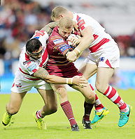 Picture by Chris Mangnall/SWpix.com - 14/07/2017 - Rugby League - Betfred Super League - Huddersfield Giants v Leigh Centurions - John Smith's Stadium, Huddersfield, England -<br /> Huddersfield's Ryan Hinchcliffe  tackled by Leighs Harrison Hansen and Danny Tickle