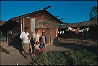 Violet and her children. Rhonda slum, Nakuru, Kenya.