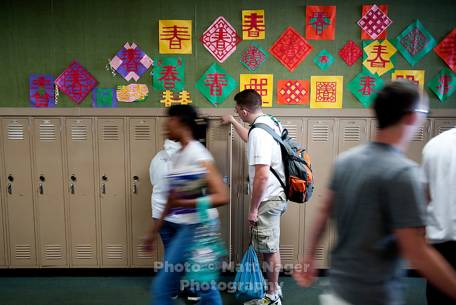 Chinese designs line the wall above lockers at Macarthur High School outside the classroom of Yue Zheng (cq), a Chinese english teacher who has been teaching for two years, in Lawton, Oklahoma, April 29, 2010. ..PHOTO/ MATT NAGER