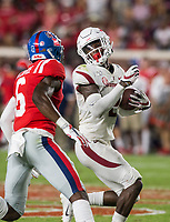 NWA Democrat-Gazette/BEN GOFF @NWABENGOFF<br /> Kamren Curl, Arkansas strong safety, evades Miles Battle, Ole Miss wide receiver, as he runs for a touchdown after stripping the ball in the fourth quarter Saturday, Sept. 7, 2019, at Vaught-Hemingway Stadium in Oxford, Miss.