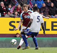 Burnley's Chris Wood looks to cross despite the attentions of Cardiff City's Bruno Ecuele Manga<br /> <br /> Photographer Rich Linley/CameraSport<br /> <br /> The Premier League - Saturday 13th April 2019 - Burnley v Cardiff City - Turf Moor - Burnley<br /> <br /> World Copyright © 2019 CameraSport. All rights reserved. 43 Linden Ave. Countesthorpe. Leicester. England. LE8 5PG - Tel: +44 (0) 116 277 4147 - admin@camerasport.com - www.camerasport.com