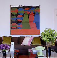 A painting by Tal R and Yantra ceramics by Ettore Sottsass decorate the living room