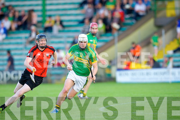 In Action Lixnaw's Ricky Heffernan gets away from Ballyheigue's Damien Casey in  Senior Hurling Championship Ballyheigue  v  Lixnaw at Austin Stack Park on Friday