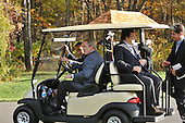 Camp David, MD - October 18, 2008 --  United States President George W. Bush, President Nicolas Sarkozy of France, who also serves as this year's rotating President of the European Union (EU), and President José Manuel Barroso of the European Commission (EC) ride a golf cart at the Presidential Retreat near Thurmont, Maryland for talks on Saturday, October 18, 2008.  The two European leaders stopped at Camp David to meet with President Bush to discuss the economy on their way home from a summit in Canada to try to convince Bush to support a summit by year's end to try to reform the world financial system.  The person at far right is unidentified..Credit: Ron Sachs / Pool via CNP