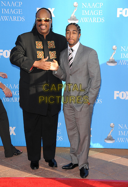 STEVIE WONDER & OMARION.Attends The 39th NAACP Image Awards held at The Shrine Auditorium in Los Angeles, California, USA..February 14th, 2008        .full length black suit grey gray shaking hands sunglasses shades goatee facial hair .CAP/DVS.©Debbie VanStory/Capital Pictures.