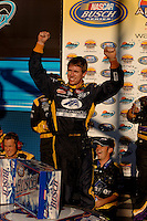 Nov 12, 2005; Phoenix, Ariz, USA;  Nascar driver Carl Edwards celebrates winning the Busch Series Arizona 200 at Phoenix International Raceway. Mandatory Credit: Photo By Mark J. Rebilas