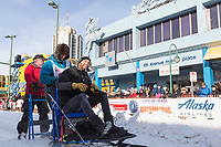 Travis Beals and team leave the ceremonial start line with an Iditarider at 4th Avenue and D street in downtown Anchorage, Alaska on Saturday March 2nd during the 2019 Iditarod race. Photo by Brendan Smith/SchultzPhoto.com