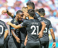 Raheem Sterling of Manchester City (left) celebrates with team mates after he scores with Riyad Mahrez of Manchester City during the Premier League match between West Ham United and Manchester City at the London Stadium, London, England on 10 August 2019. Photo by David Horn.