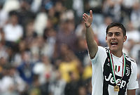 Calcio, Serie A: Juventus - Hellas Verona, Torino, Allianz Stadium, 19 maggio, 2018.<br /> Juventus' Paulo Dybala celebrates during the victory ceremony following the Italian Serie A football match between Juventus and Hellas Verona at Torino's Allianz stadium, 19 May, 2018.<br /> Juventus won their 34th Serie A title (scudetto) and seventh in succession.<br /> Gianluigi Buffon played his last match with Juventus today after 17 years.<br /> UPDATE IMAGES PRESS/Isabella Bonotto