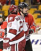 Brian McCafferty (Harvard - 20), Dennis McCauley (NU - 12) - The Northeastern University Huskies defeated the Harvard University Crimson 3-1 in the Beanpot consolation game on Monday, February 12, 2007, at TD Banknorth Garden in Boston, Massachusetts.