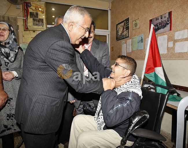 Palestinian Prime Minister Salam Fayyad during the lunch of the International Disabled Day events in the West Bank city of Nablus on Dec 3,2009. Photo by Mustafa Abu Dayeh.