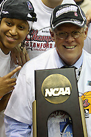 BERKELEY, CA - MARCH 30: Stanford University president John Hennessey poses with the regional champions trophy following Stanford's 74-53 win against the Iowa State Cyclones on March 30, 2009 at Haas Pavilion in Berkeley, California.